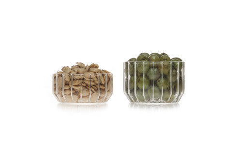 Modern glass bowls in fluted glass filled with nuts and olives by designer Felicia Ferrone.