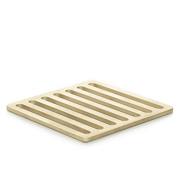 Designer trivet inspired by the streets of Milan, Italy, and made of solid brass with a sandblasted finish.