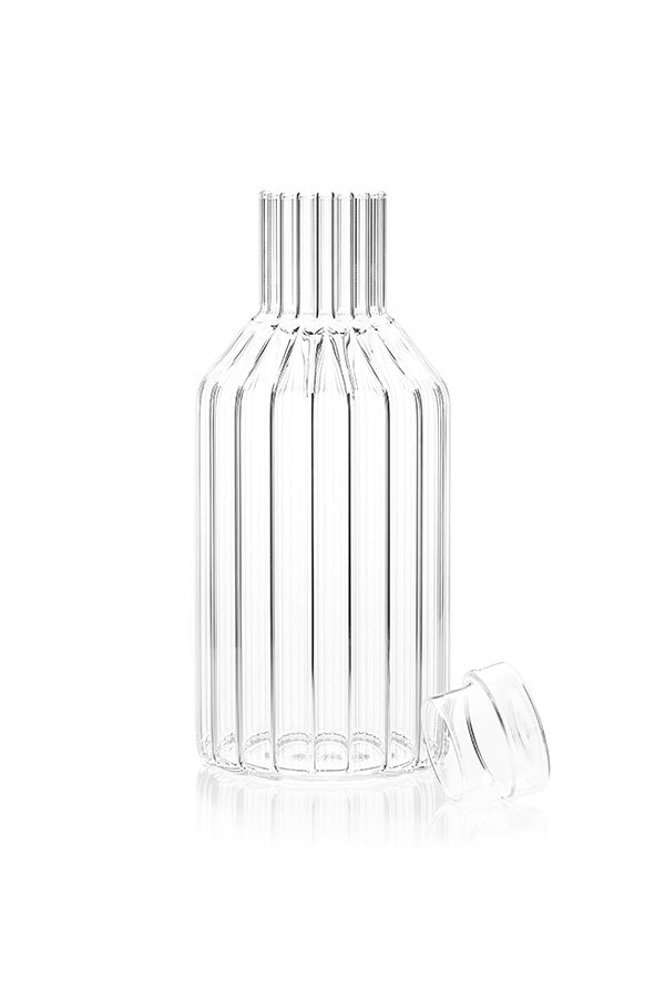 Modern, designer carafe in fluted glass with lid off.