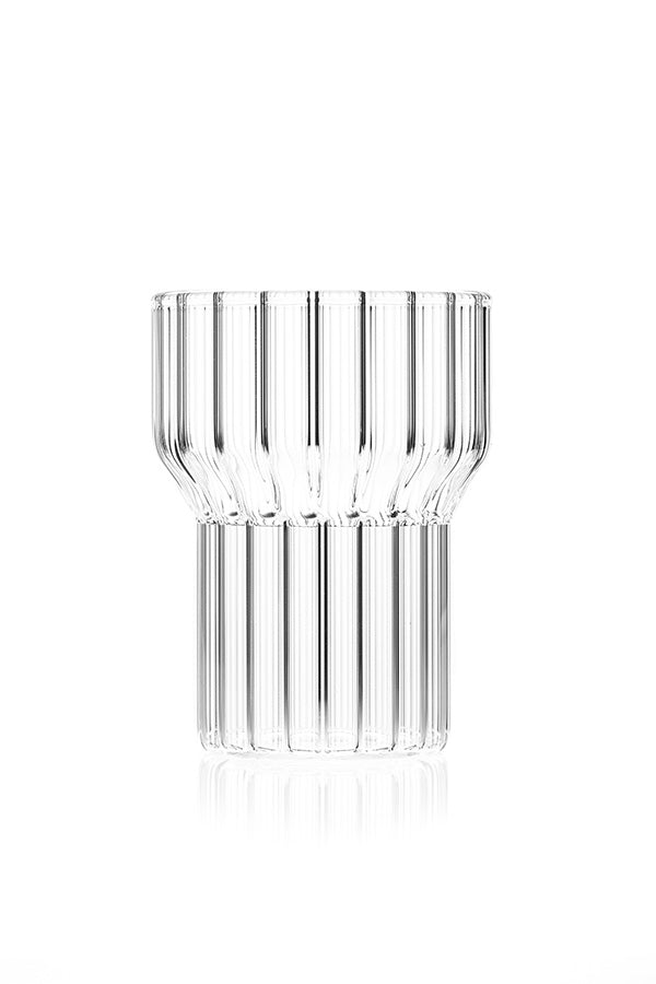 Empty, clear fluted glass by contemporary designer, Felicia Ferrone.