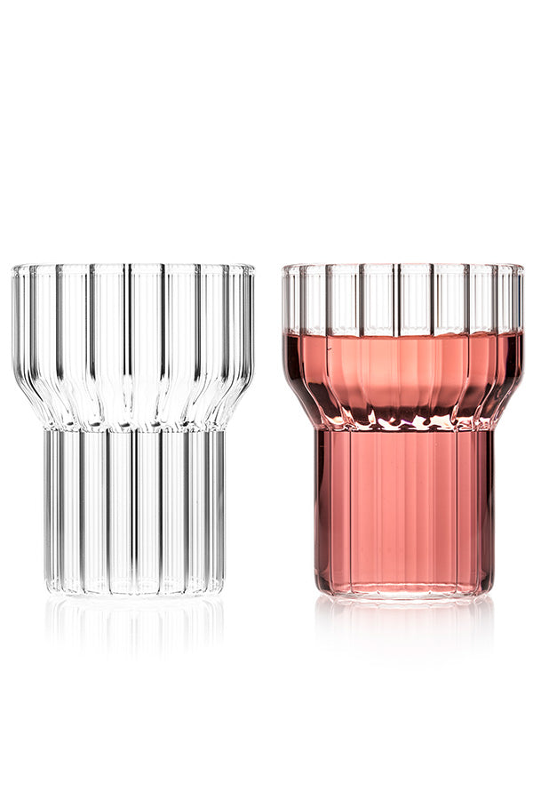 Pair of contemporary, fluted glasses. One glass is clear and the other contains a pink wine.