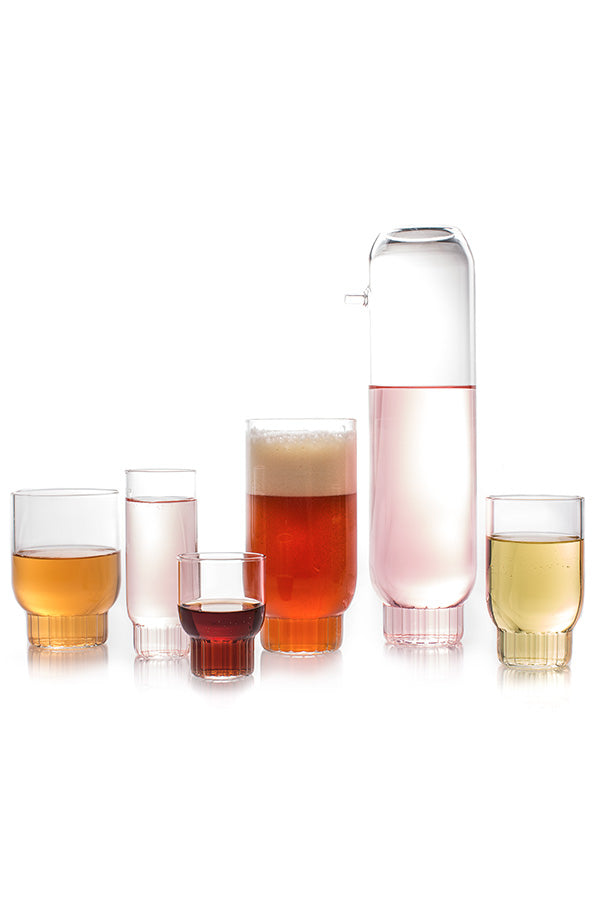 The entire modern Rasori Collection of glassware containing colorful liquids.