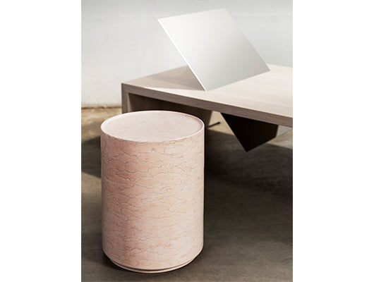 Pink marble side table with daybed.