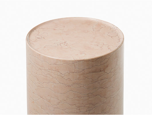Close up of pink marble side table.