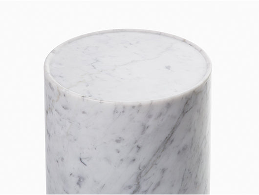 Close up of white and grey marble side table.
