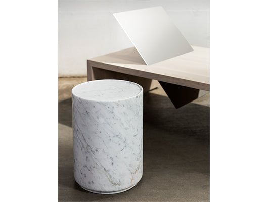 White and grey marble side table with daybed.