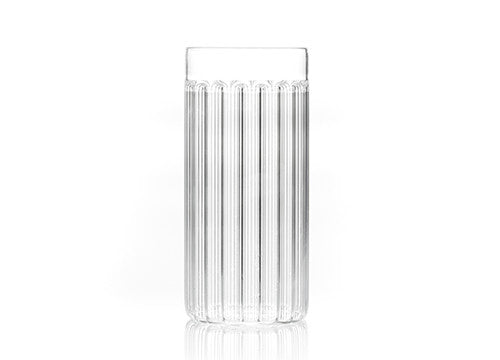 Designer tall glass in fluted glass by Felicia Ferrone.