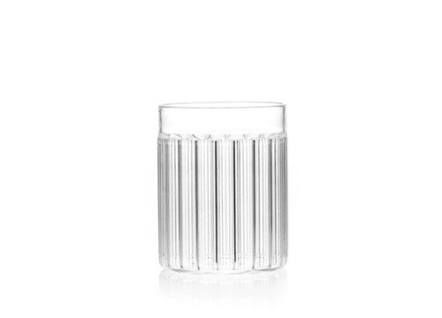 "Designer tumbler glass in fluted glass called ""Bessho Tumbler"" by Felicia Ferrone."