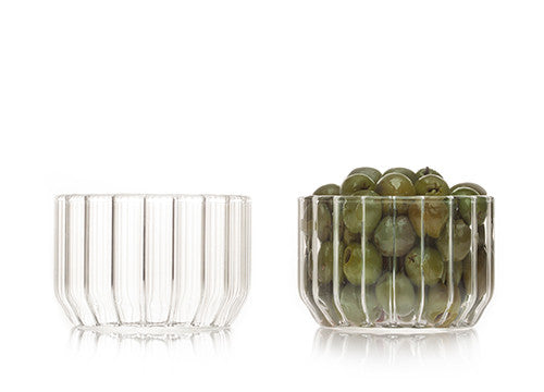 Designer glass bowls in fluted glass and filled with olives by Felicia Ferrone.