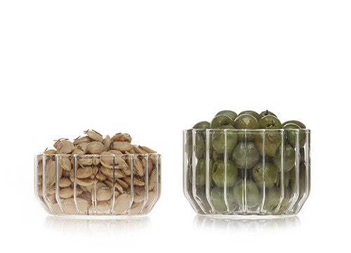 Designer glass bowl in fluted glass filled with nuts and olives by Felicia Ferrone.