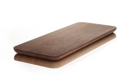 Walnut side up on a rectangular cutting board composed of walnut and maple.