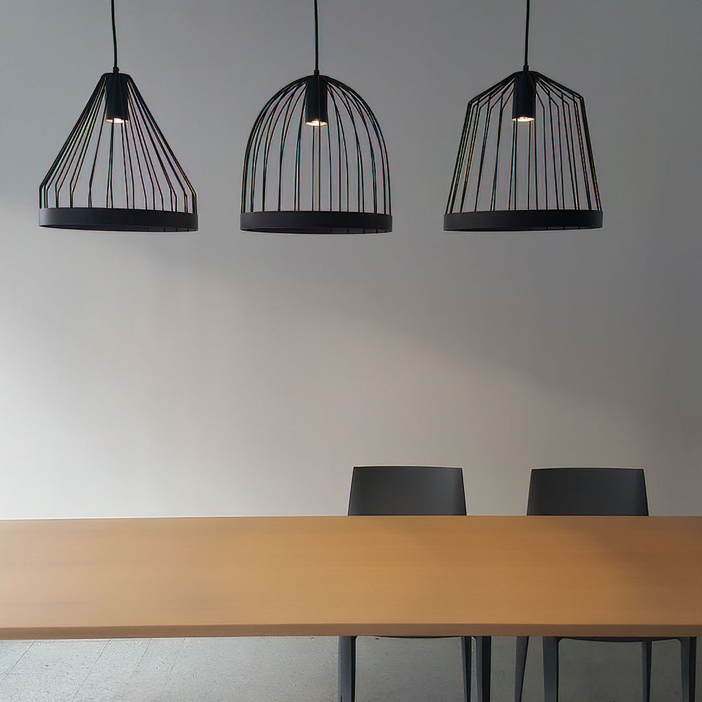 Hanging bird cage lamps above a table and chairs.