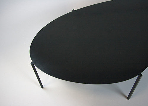 Close up of designer black metal table for contemporary living space.
