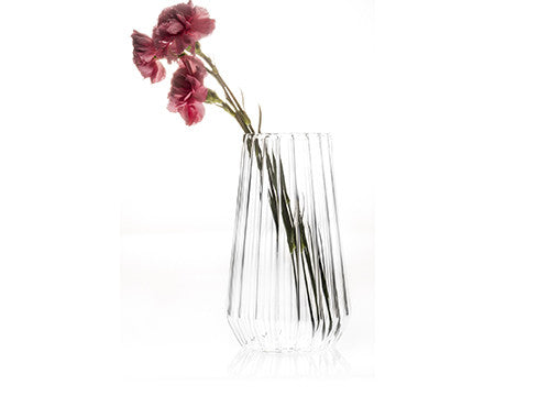 Fluted glass flower vase with carnations by designer Felicia Ferrone.