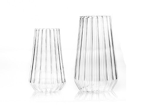 Fluted glass flower vases in medium and large by designer Felicia Ferrone.
