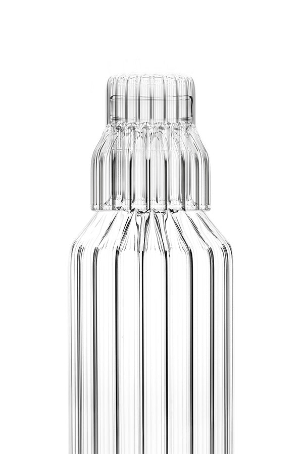 Close up of the small fluted glass that fits on top of the fluted glass bedside table carafe.
