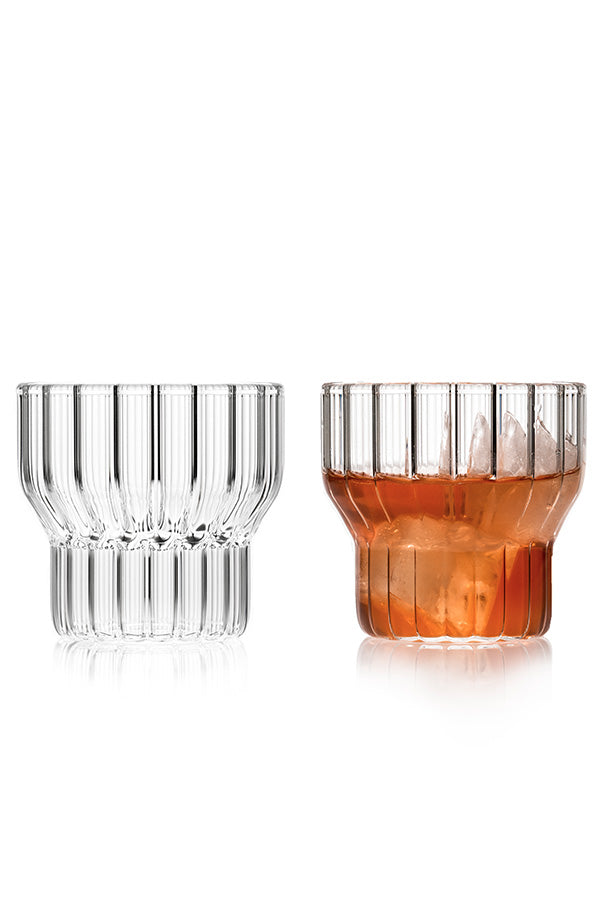 A pair of low, fluted, designer drinking glasses.
