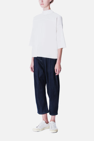 CURVED TROUSER WITH FRONT PLEATS