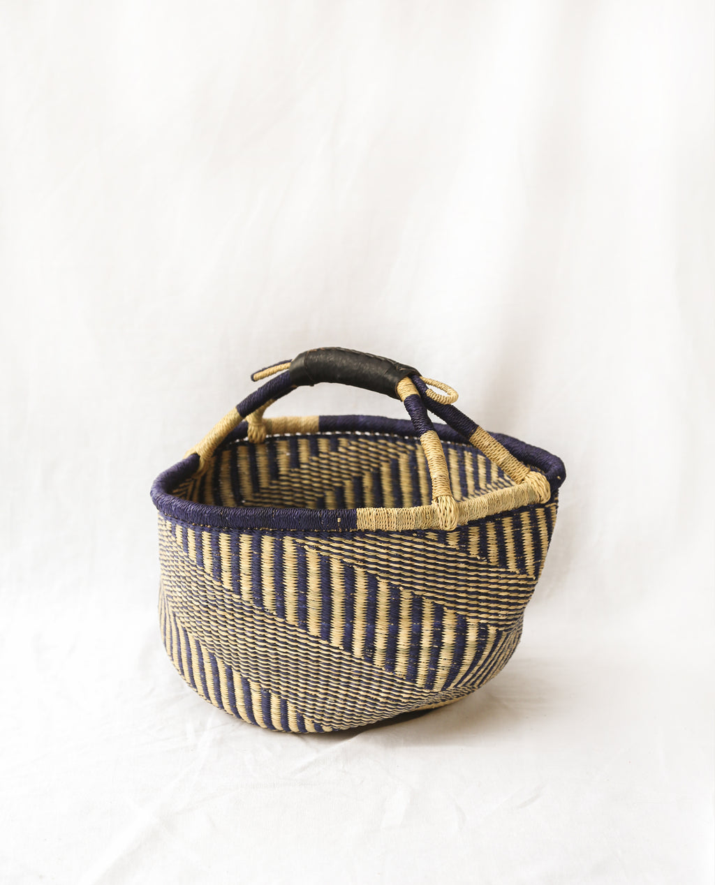 AKUA Round Straw Basket With Leather Detail Handles