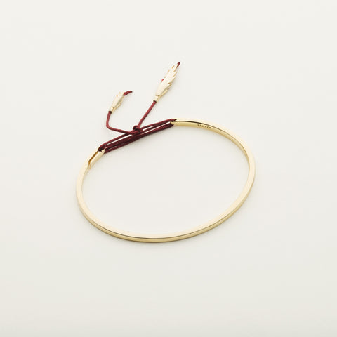 Thread and feather bracelet - gold plated