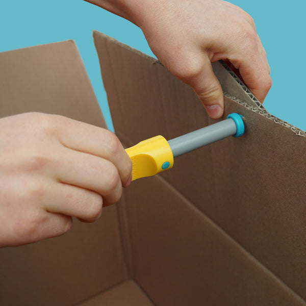 Makedo SCRU DRIVER cardboard construction tool in use connecting cardboard.