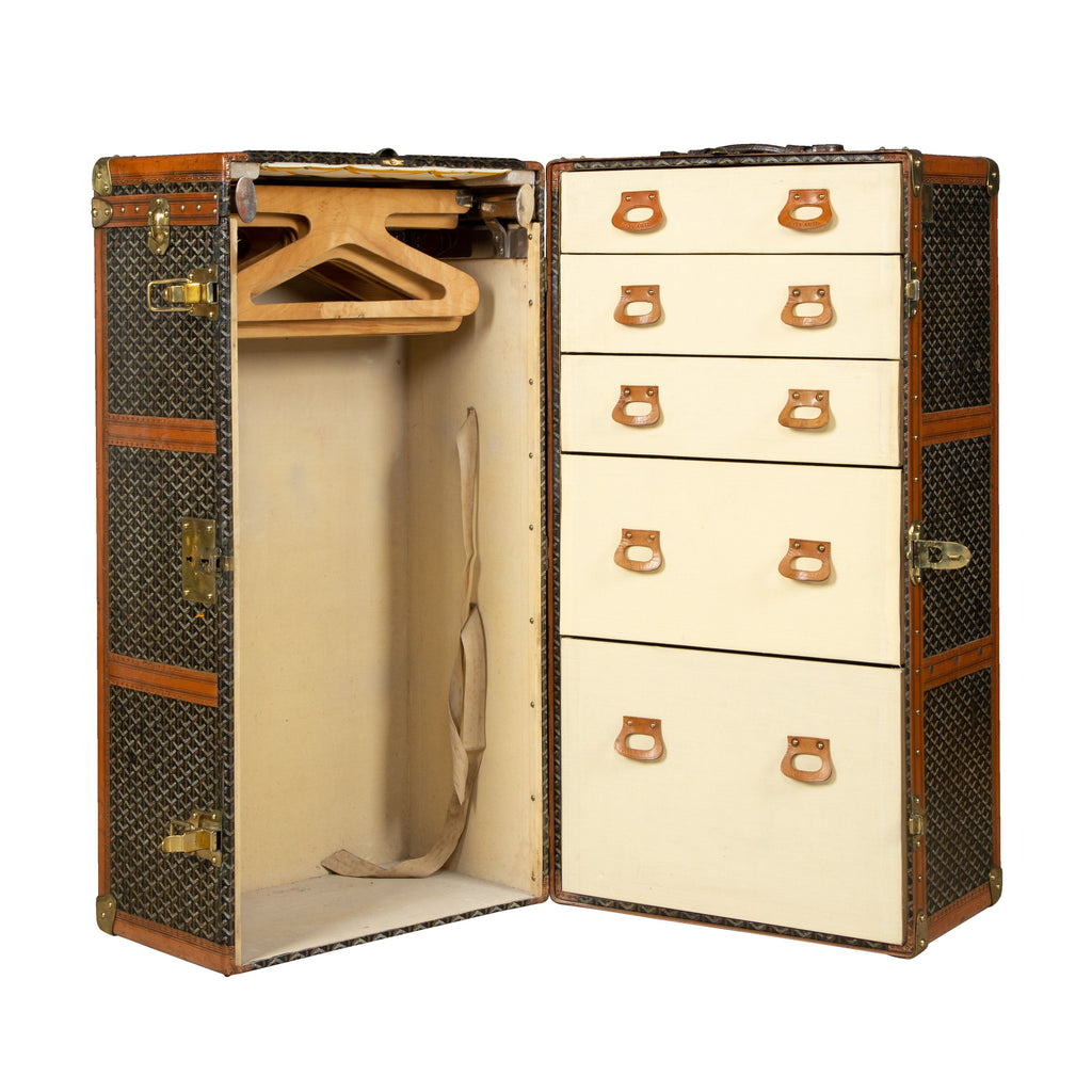 A large Goyard wardrobe trunk