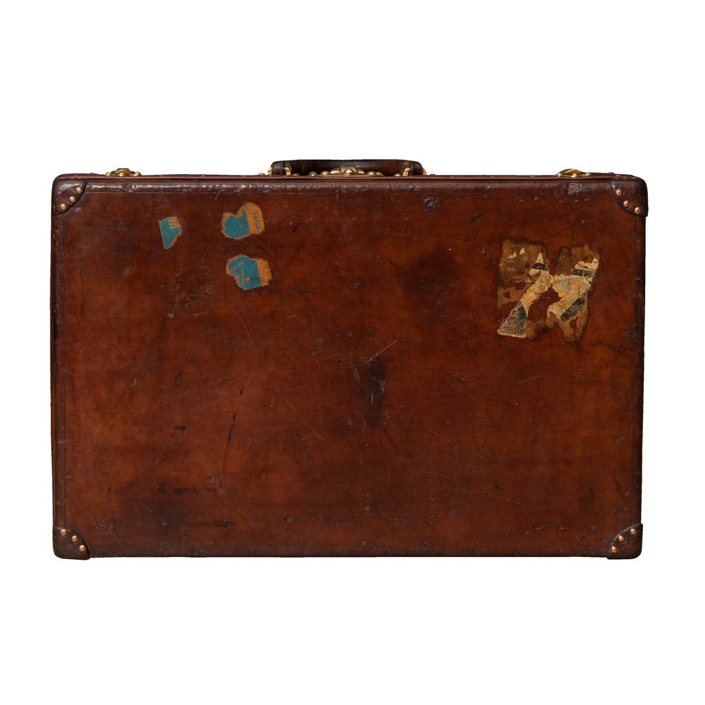 A Louis Vuitton suitcase in natural cow hide