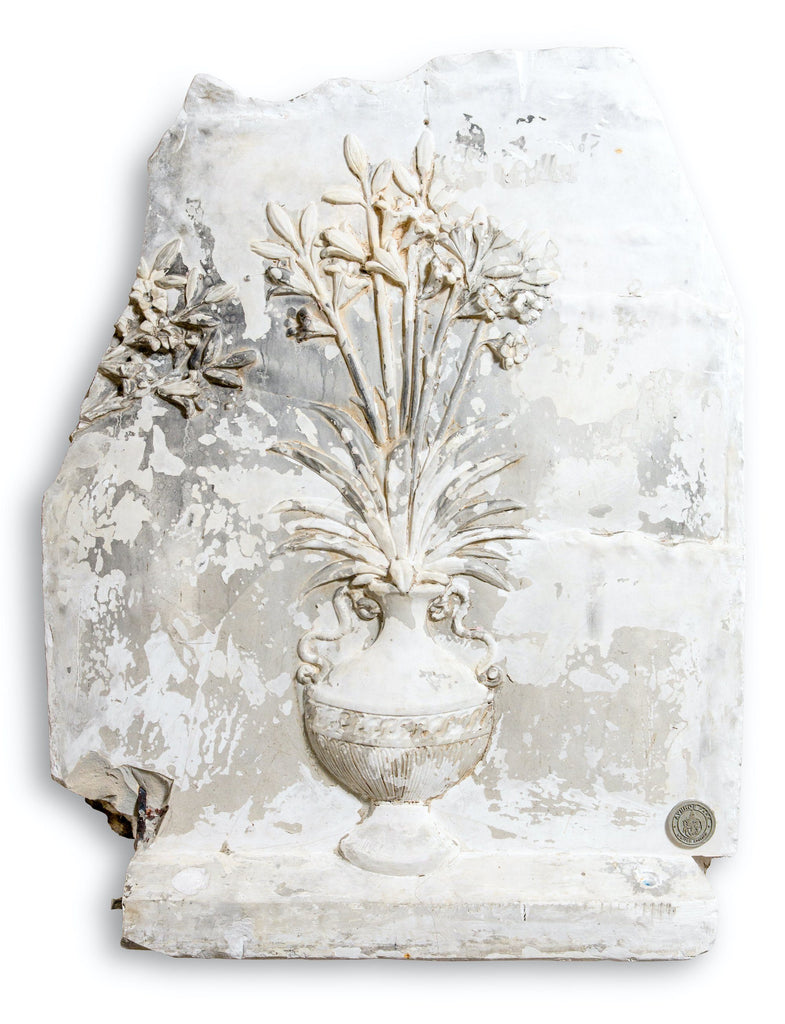 A plaster panel of a flowering vase