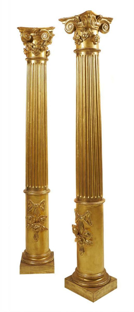 An Exquisite Pair of Carved and Giltwood Columns