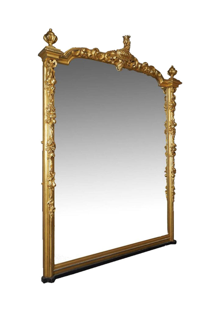 A Large Scottish Baronial Carved Giltwood Overmantel Mirror