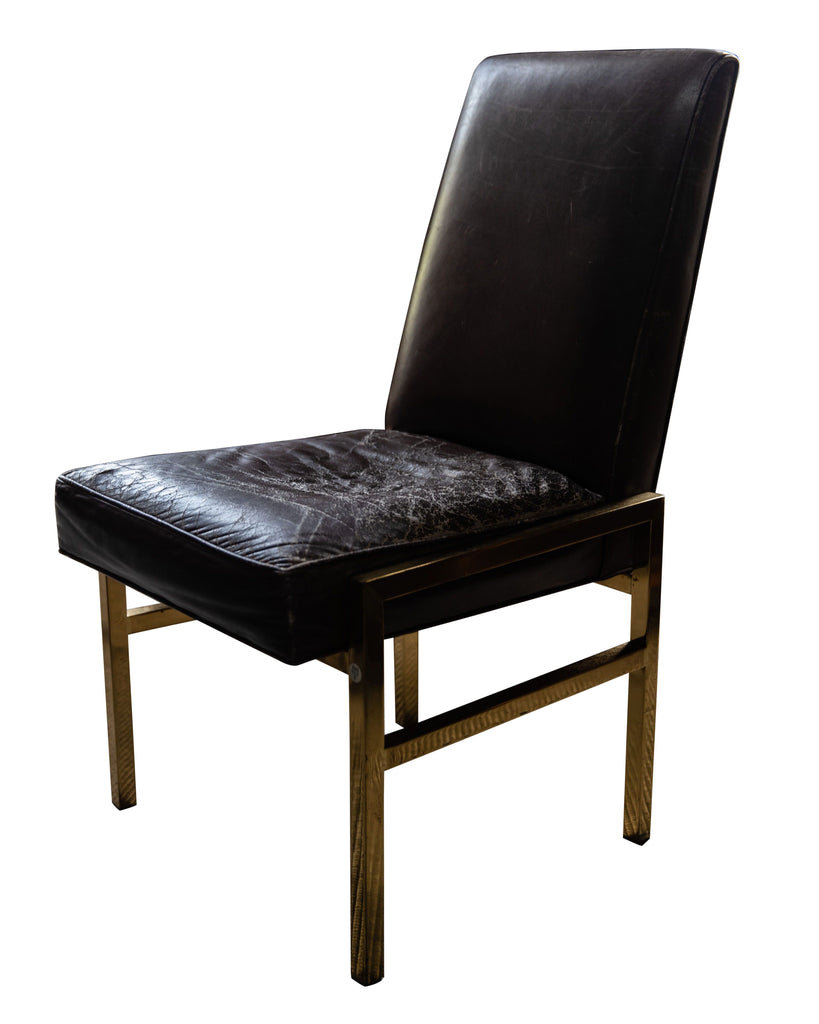 A Set of Four Gilt Metal and Brown Leather Chairs