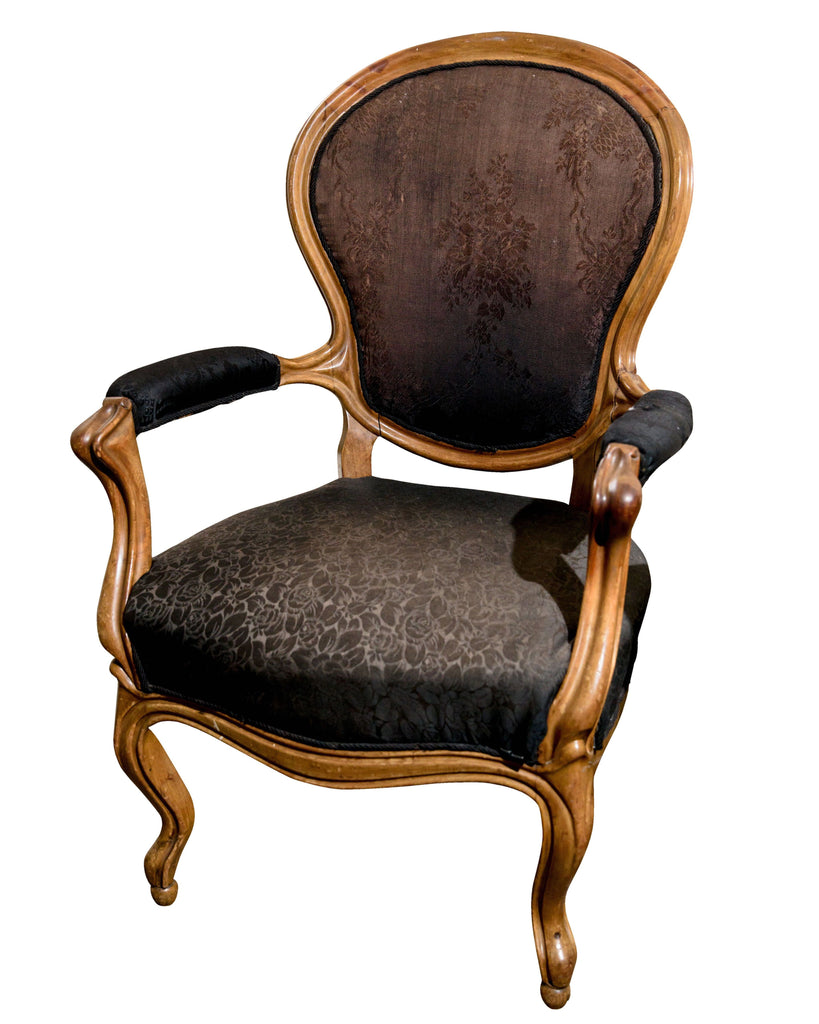 A Victorian Carved Mahogany Armchair