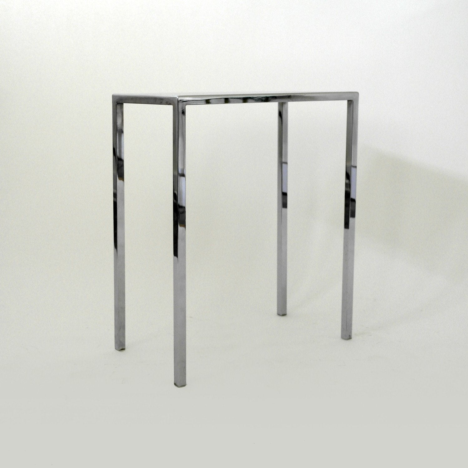 pair of chrome side tables by philippe starck – a modern grand tour -