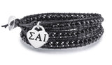 Sigma Alpha Iota Greek Letters Heart Charm on Black Wrap Bracelet
