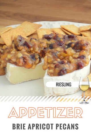 Appetizer - Pecan Apricot Brie Cheese with Cranberries.