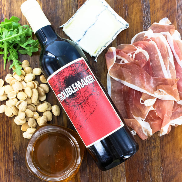 Honey, Marcona Almonds, Prosciutto Ham, Humboldt Fog® Cheese With a Red Blend