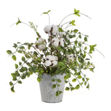 Cotton stems arranged perfectly in a rustic metal pot