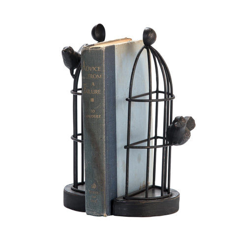 Farmhouse or country cottage style bird cage bookends with an antiqued black painted finish and metal bird finial accents