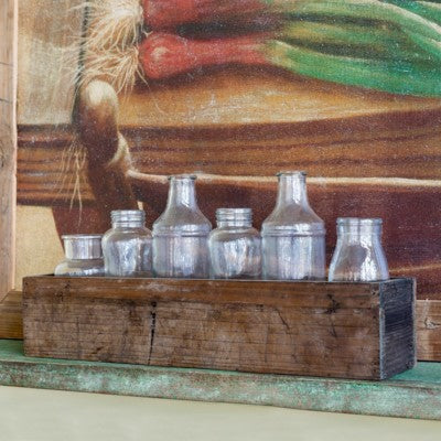 Found Bottles in a Rustic Wooden Planter Box