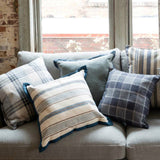 Farmhouse pillow with blue and white striped ticking and velvet flange