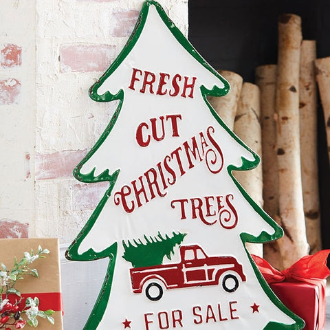 farmhouse or country cottage style metal holiday sign featuring a vintage truck hauling a tree