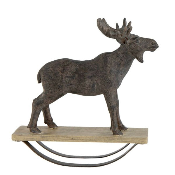 Rustic and distressed holiday rocking moose
