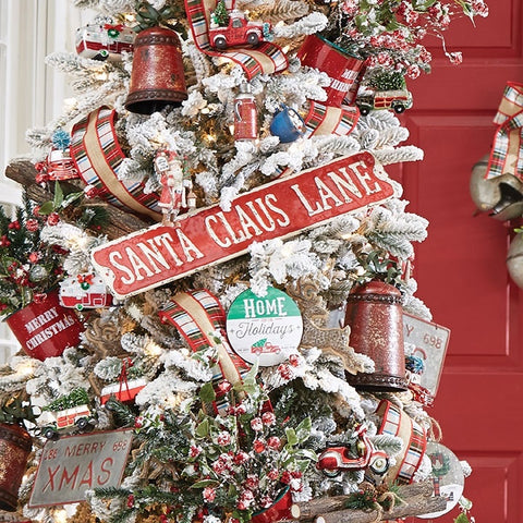 "Metal Holiday Sign resembling a vintage Street Sign and reading ""Santa Clause Lane"". Perfect for a country cottage, cozy cabin or festive farmhouse."