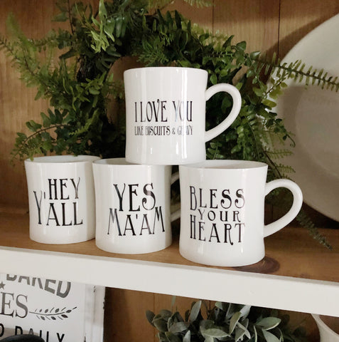 "Southern Sayings Ceramic Mug Set of Two Featuring""Hey Y'all"", ""I Love You Like Biscuits and Gravy"", ""Bless Your Heart"" and ""Yes Ma'am"" so fun for coffee or tea!"