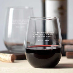 Stemless wine glasses with famous wine drinkers' quotes.