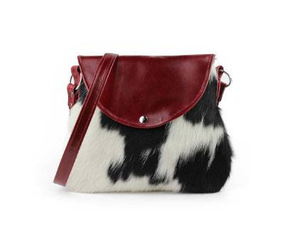 COWHIDE CROSSBODY BAG, BLACK & WHITE WITH RED LEATHER