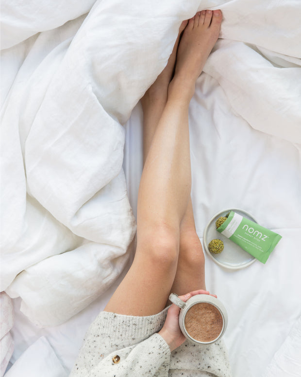 The perfect breakfast in bed, warm cocoa and pistachio organic energy balls