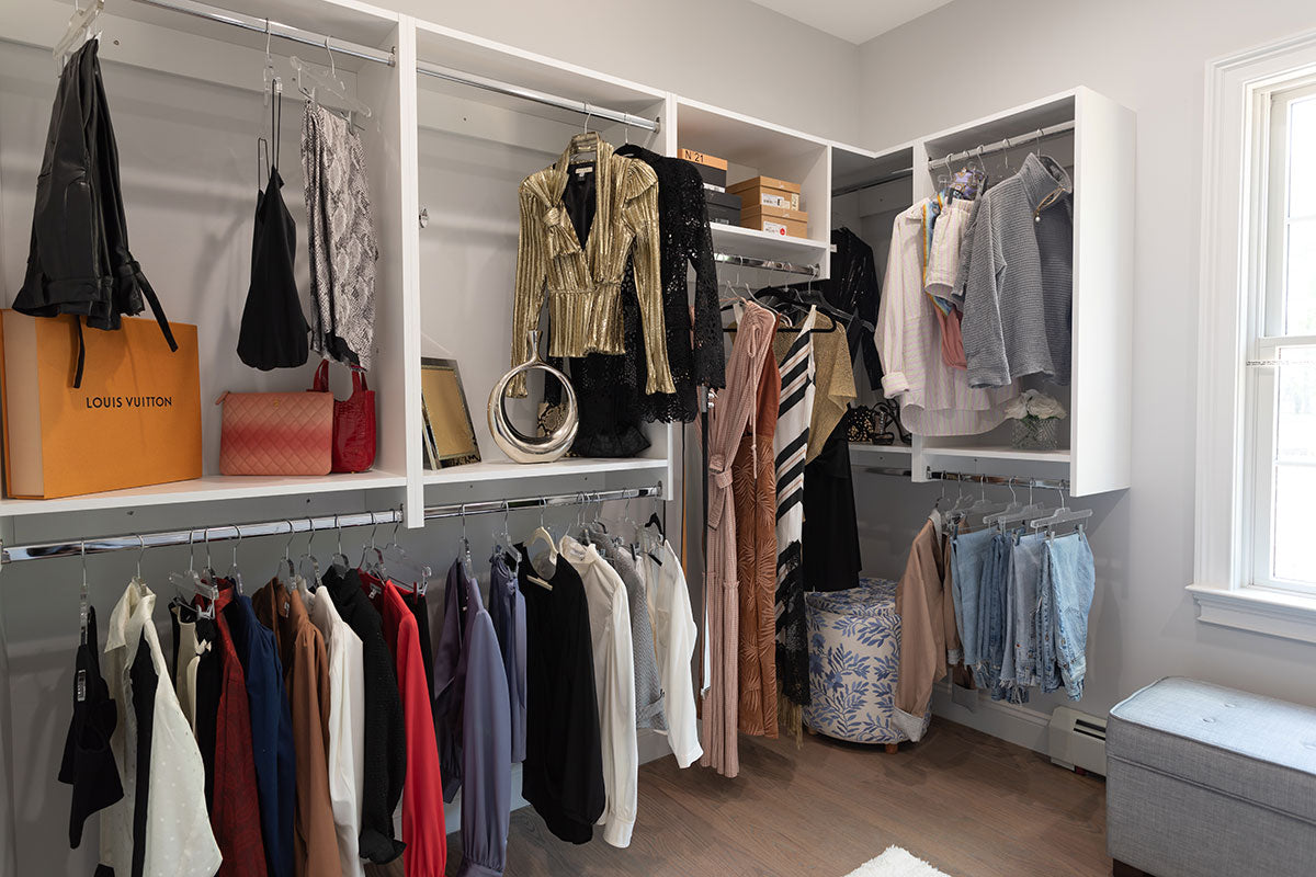 closet with shelving for shoes and clothing