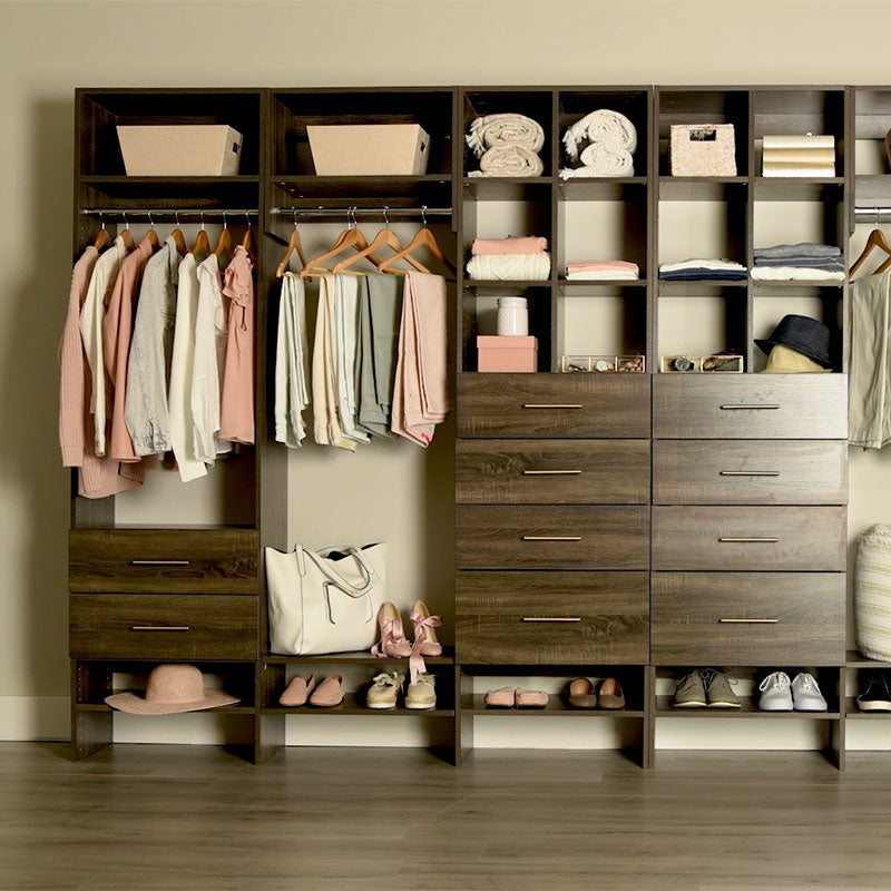 Custom closet system with drawers, shelves, and hanging rods