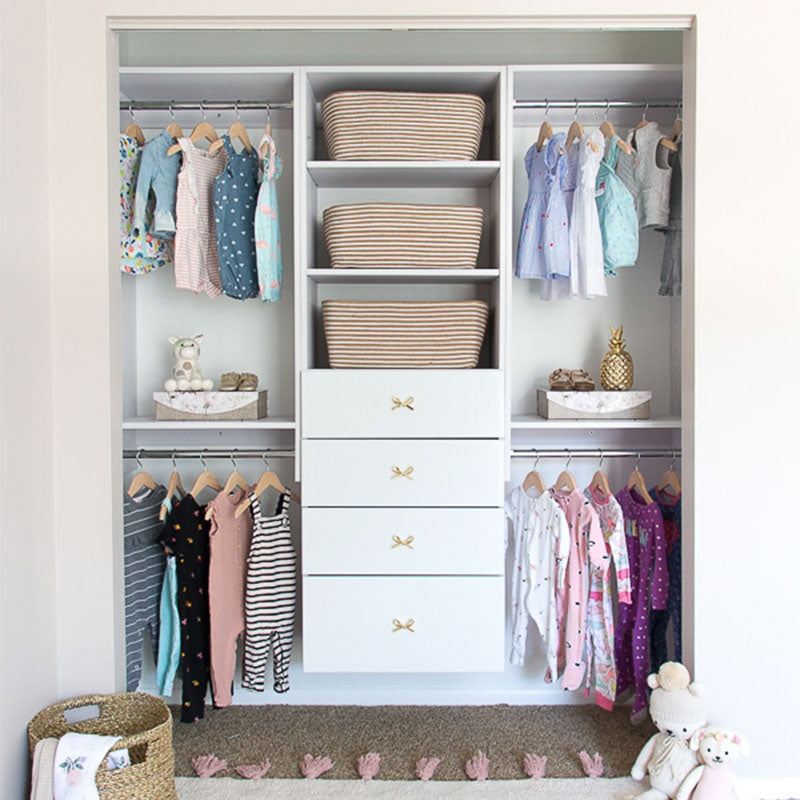 Closet organizer for a toddler with hanging clothes and drawers